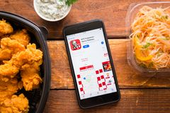Smartphone with mobile application. Stavropol, Russian Federation. June 10, 2019. Smartphone with mobile application KFC Indonesia-Home Delivery royalty free stock image
