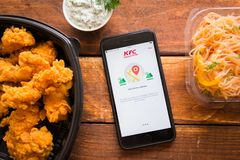 Smartphone with mobile application. Stavropol, Russian Federation. June 10, 2019. Smartphone with mobile application KFC Indonesia-Home Delivery stock photo