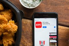 Smartphone with mobile application. Stavropol, Russian Federation. June 10, 2019. Smartphone with mobile application KFC online Food ordering royalty free stock images