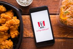 Smartphone with mobile application. Stavropol, Russian Federation. June 10, 2019. Smartphone with mobile application KFC online Food ordering stock images