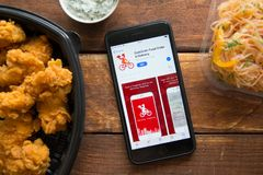 Smartphone with mobile application. Stavropol, Russian Federation. June 10, 2019. Smartphone with mobile application QuikGrab-Food Order Delivery royalty free stock photography