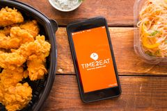 Smartphone with mobile application. Stavropol, Russian Federation. June 10, 2019. Smartphone with mobile application Time2eat-Tafeaway food Delivery royalty free stock image