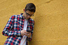 Smartphone, mobile. Boy casual style with smartphone Stock Photography