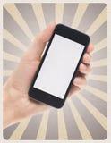 Smartphone mobile a disposizione su retro fondo Fotografia Stock Libera da Diritti