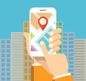 Smartphone with mobile map gps navigation on screen. Hand holding smartphone and touching screen with mobile map gps navigation. Finding the way concept. Flat Stock Photography