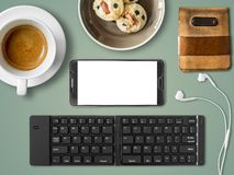 Smartphone mobile office set of digital nomad job. Top view of Mobile office working with smartphone and bluetooth keyboard in cafe as digital nomad job Stock Images