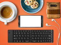 Smartphone mobile office set of digital nomad job. Top view of Mobile office working with smartphone and bluetooth keyboard in cafe as digital nomad job Stock Photography