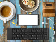 Smartphone mobile office set of digital nomad job. Top view of Mobile office working with smartphone and bluetooth keyboard in cafe as digital nomad job Royalty Free Stock Photo