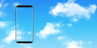 Smartphone, mobile phone over blue sky Royalty Free Stock Photography