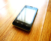 Smartphone mobile phone. Smart phone on the floor Stock Photos