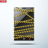 Smartphone, mobile phone wrapped danger tape. Royalty Free Stock Photography