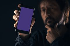 Smartphone mock up in male hand stock image