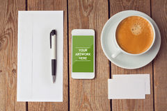 Smartphone mock up template for business presentations and apps design. Over wooden table Royalty Free Stock Photos