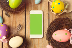 Smartphone mock up template for easter holiday app presentation Royalty Free Stock Images
