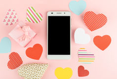 Smartphone mock up template for Valentine's day with heart shape Royalty Free Stock Photo