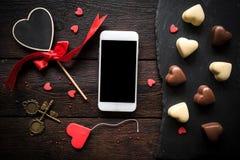 Smartphone mock Valentine`s day background Stock Images