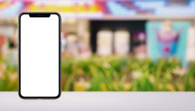 Smartphone mockup similar to iPhone X front and back sides on the desk in mall banner with copy space. Smartphone mockup similar to iPhone X front and back sides royalty free stock photo