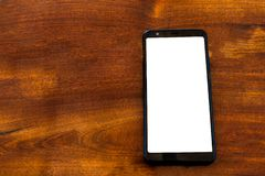 Smartphone mockup na drewnianym stole obraz stock
