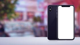 Smartphone-model voor en achterkanten op het bureau in koffiebanner met exemplaarruimte Stock Foto's