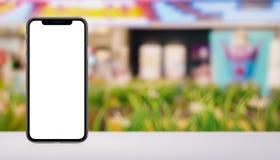Smartphone-model voor en achterkanten op het bureau in wandelgalerijbanner met exemplaarruimte Royalty-vrije Stock Foto