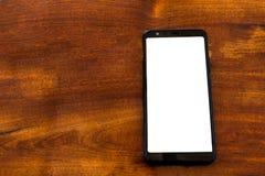 Smartphone modell på trätabellen fotografering för bildbyråer