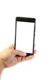Smartphone moderno con lo schermo in bianco in una mano femminile Immagine Stock