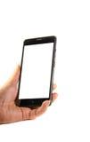 Smartphone moderno con lo schermo in bianco in una mano femminile Fotografia Stock Libera da Diritti