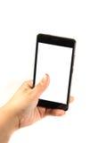 Smartphone moderno con lo schermo in bianco in una mano femminile Immagine Stock Libera da Diritti