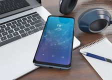 Smartphone moderno que coloca na rendição desktop do modelo 3d ilustração royalty free
