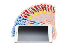 Smartphone and Money of Indonesian Rupiah Royalty Free Stock Image