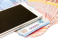 Smartphone and Money of Indonesian Rupiah Royalty Free Stock Photo