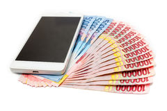 Smartphone and Money of Indonesian Rupiah Royalty Free Stock Images