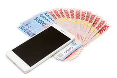 Smartphone and Money of Indonesian Rupiah Stock Images