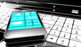 Smartphone na laptopie Obraz Royalty Free