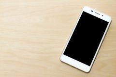 Smartphone na madeira Fotografia de Stock Royalty Free