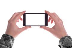 Smartphone nas mãos Fotos de Stock