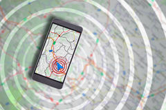 Smartphone with navigation assistant and cartography background Royalty Free Stock Images