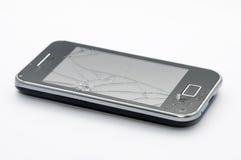 Smartphone negro con la pantalla agrietada Imágenes de archivo libres de regalías