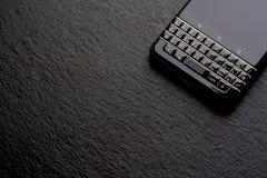 Smartphone negro del negocio, pizarra Fotografía de archivo