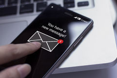 Smartphone and new message icon. Royalty Free Stock Photo