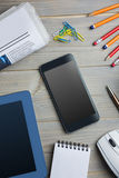 Smartphone next to the newspaper notepad tablet and pen Royalty Free Stock Photos