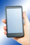 Smartphone no azul Fotografia de Stock Royalty Free