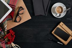 Smartphone with notebook and cup of coffee on wooden background. Cell phone with writing set with espresso. Smartphone with notebook and cup of coffee on wooden Stock Images