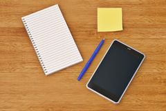 Smartphone  notebook stickers and  pen on wooden desktop.3D illu. Stration Royalty Free Stock Photos