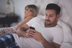 Smartphone obsession causing problems. In marriages stock photos