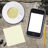 Smartphone och kaffekopp Royaltyfria Bilder