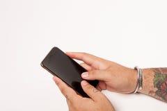 Smartphone och man Royaltyfria Bilder