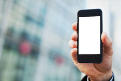 Smartphone on office buildings background stock photos