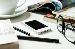 Smartphone on office table Stock Photography