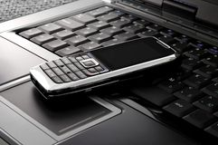 Smartphone On A Laptop Stock Photography